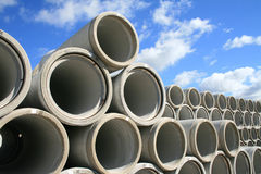 Stockpile of water pipes. A picture of water pipes, stored out in the open in stacks Stock Images