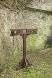 Stocks. Medieval Wooden Stocks in castle grounds Stock Images