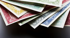Stocks and Bonds Closeup. On a white background Royalty Free Stock Photo