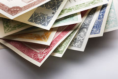 Stocks and Bonds Closeup. On a white background Royalty Free Stock Photos