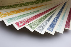 Stocks and Bonds Closeup. On a white background Royalty Free Stock Image