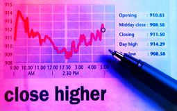 Stocks chart - close higher. A pen on a stocks chart Royalty Free Stock Image