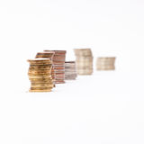 Stocks of coins. Five stock of coins on the white background isolated Stock Photos