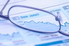 Stocks and glasses. New paper - stocks and glasses royalty free stock images