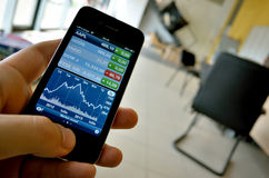 Stocks  graph on digital smartphone display Stock Photography