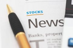 Stocks News, pen, calculator, banks, property headlines. Shallow depth of field to bring attention to text Royalty Free Stock Images