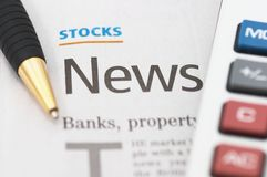 Stocks News, pen, calculator, banks, property headlines Royalty Free Stock Photo