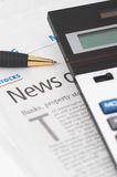 Stocks News, pen, calculator, banks, property headlines Royalty Free Stock Photography