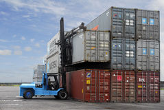 Stockyard with cargo container. And forklift Stock Image