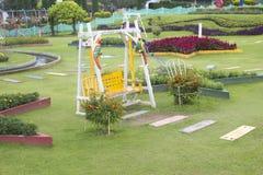 Stoel in de tuin Royalty-vrije Stock Afbeeldingen
