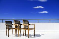 Stoel drie op balkon stock foto