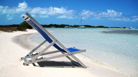 Stoel en strand Stock Foto