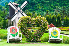 Stoel in liefdetuin Stock Foto