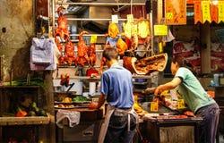 Stoepverkopers die Geroosterde Eend en Kip in Hong Kong S verkopen Stock Afbeeldingen