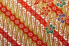 Stof met bloemenbatikpatroon Stock Fotografie