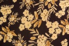 Stof van bloemenpatroon met donkere achtergrond stock foto's