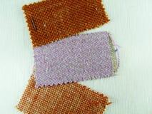 Stoffenmonsters in warme tonen Stock Foto