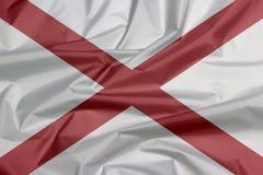 Stoffenvlag van Alabama Vouw van de vlagachtergrond van Alabama, de staten van Amerika royalty-vrije illustratie