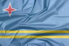 Stoffenvlag van Aruba Vouw van de vlagachtergrond van Aruba vector illustratie