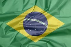 Stoffenvlag van Brazilië Vouw van Braziliaanse vlagachtergrond vector illustratie