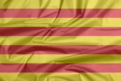 Stoffenvlag van Catalonië Vouw van Catalunya-vlagachtergrond vector illustratie