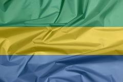 Stoffenvlag van Gabon Vouw van Gabones-vlagachtergrond royalty-vrije illustratie