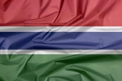 Stoffenvlag van Gambia Vouw van Gambiaanse vlagachtergrond stock illustratie