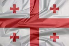 Stoffenvlag van Georgië Vouw van Georgische vlagachtergrond stock illustratie