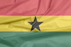 Stoffenvlag van Ghana Vouw van Ghanese vlagachtergrond royalty-vrije illustratie