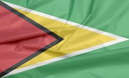 Stoffenvlag van Guyana Vouw van Guinese vlagachtergrond royalty-vrije illustratie