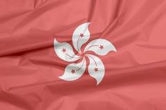 Stoffenvlag van Hongkong Vouw van de vlagachtergrond van Hongkong royalty-vrije illustratie
