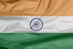 Stoffenvlag van India Vouw van Indische vlagachtergrond royalty-vrije illustratie