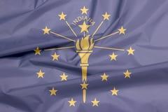 Stoffenvlag van Indiana Vouw van de vlagachtergrond van Indiana, de staten van Amerika stock illustratie