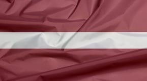 Stoffenvlag van Letland Vouw van Letse vlagachtergrond royalty-vrije illustratie