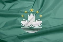 Stoffenvlag van Macao Vouw van de vlagachtergrond van Macao vector illustratie