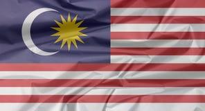 Stoffenvlag van Maleisië Vouw van Maleise vlagachtergrond royalty-vrije illustratie