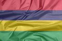 Stoffenvlag van Mauritius Vouw van Mauritiaanse vlagachtergrond vector illustratie