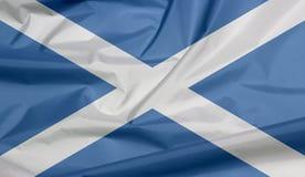 Stoffenvlag van Schotland Vouw van de vlagachtergrond van Schotland royalty-vrije illustratie