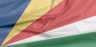 Stoffenvlag van Seychellen Vouw van de vlagachtergrond van Seychellen vector illustratie