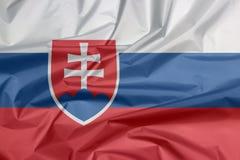 Stoffenvlag van Slowakije Vouw van Slowaakse vlagachtergrond vector illustratie