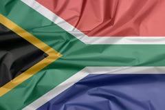 Stoffenvlag van Zuid-Afrika Vouw van Zuidafrikaanse vlagachtergrond stock illustratie