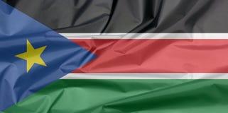 Stoffenvlag van Zuid-Soedan Vouw van achtergrond van de Zuiden de Soedanese vlag royalty-vrije illustratie