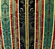Stoffering met motiefpatroon, rode, groene, en zwarte kleuren stock foto