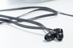 Stoffig paar oortelefoons 3 stock fotografie