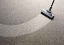 Stofzuiger op een tapijt