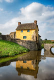 Stogursey Castle in Somerset. A pretty thatched cottage built in to the ruins of Stogursey Castle in Somerset Royalty Free Stock Image