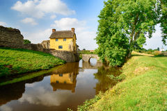 Stogursey Castle in Somerset. A pretty thatched cottage built in to the ruins of Stogursey Castle in Somerset Stock Photos