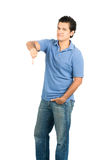 Stoic Emotionless Hispanic Male Thumb Down Full V. Hispanic male looking at camera in blue casual clothes with emotionless facial expression, gesturing thumb Stock Image