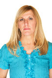 Stoic Mature Woman. Stoic middle aged white woman on isolated background Royalty Free Stock Photos