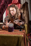Stoic Soothsayer. Stoic handsome gypsy man with crystal ball Royalty Free Stock Images